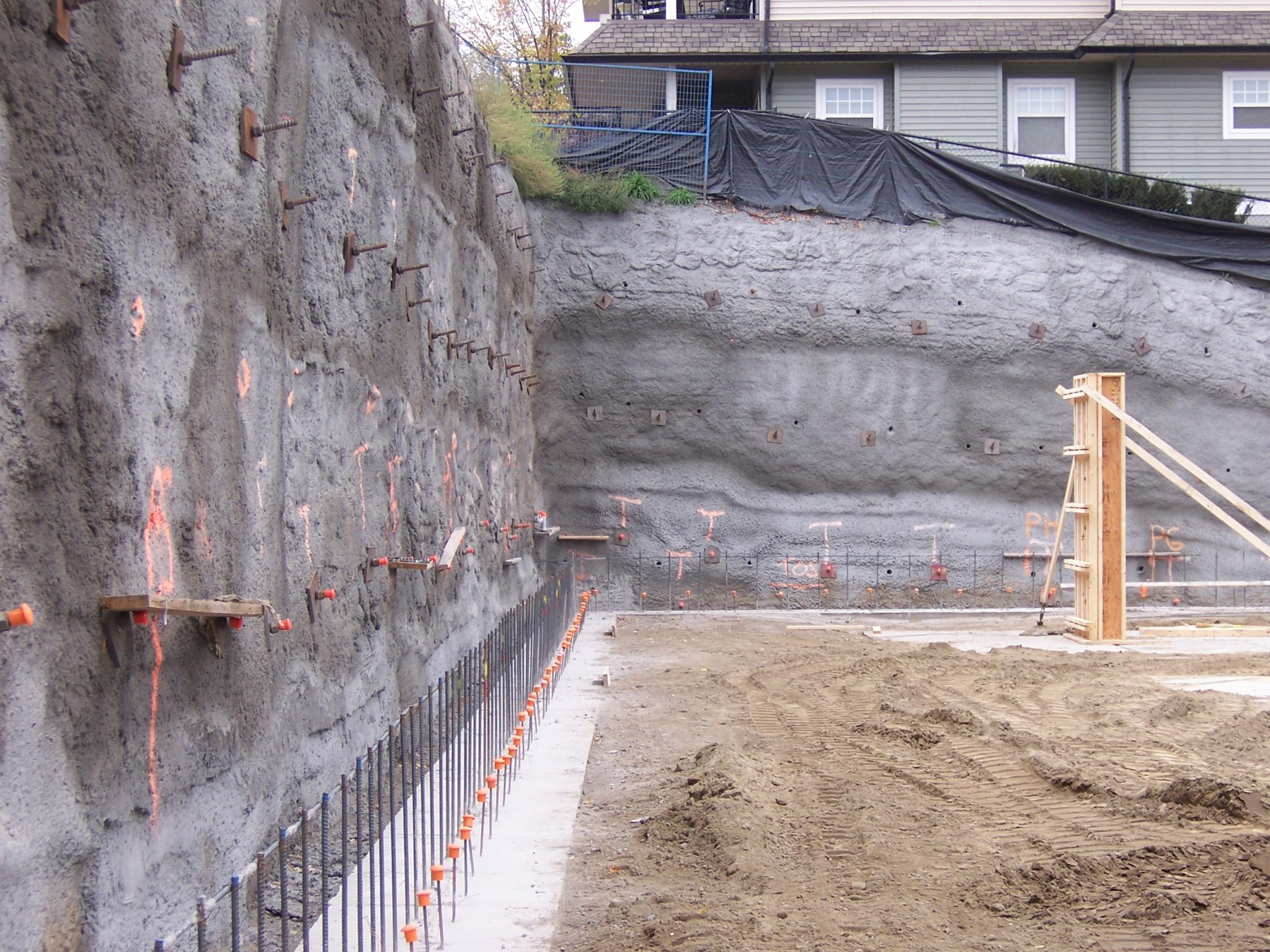 vertical earth wall held in place with shotcrete and soil nails