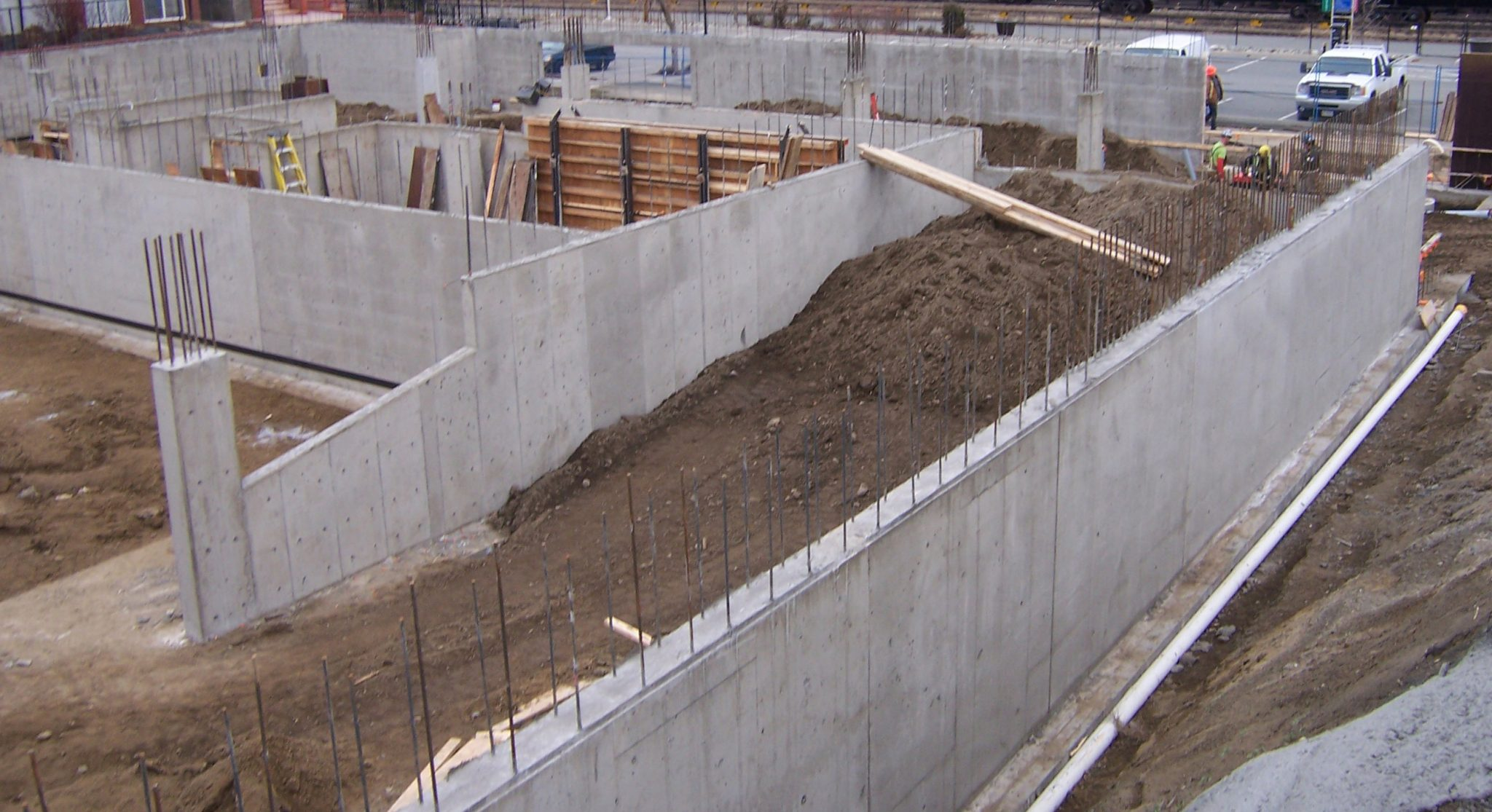 concrete walls with dirt and rebar